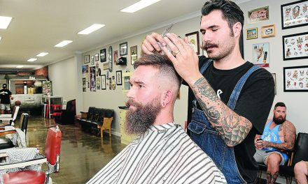 Sam slips into his new barber's shop
